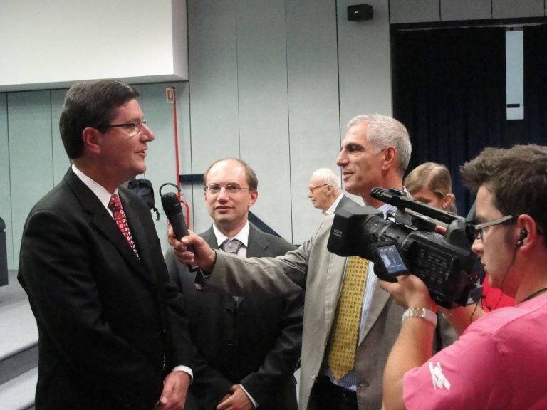 Jere Palazzolo being interviewed by press at collaboration ceremony in San Giovanni Rotondo, Italy