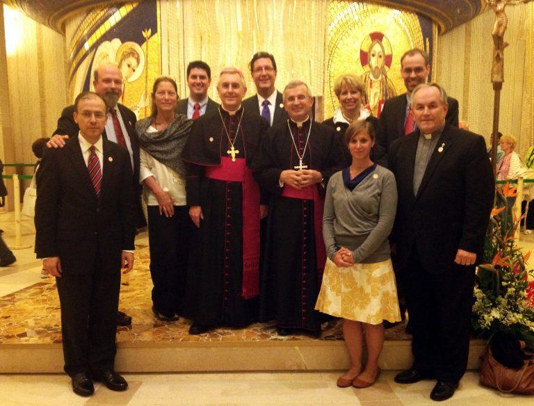 CHI Leadership Team & Archbishop Castoro in St. Pio's Crypt in San Giovanni Rotondo, Italy
