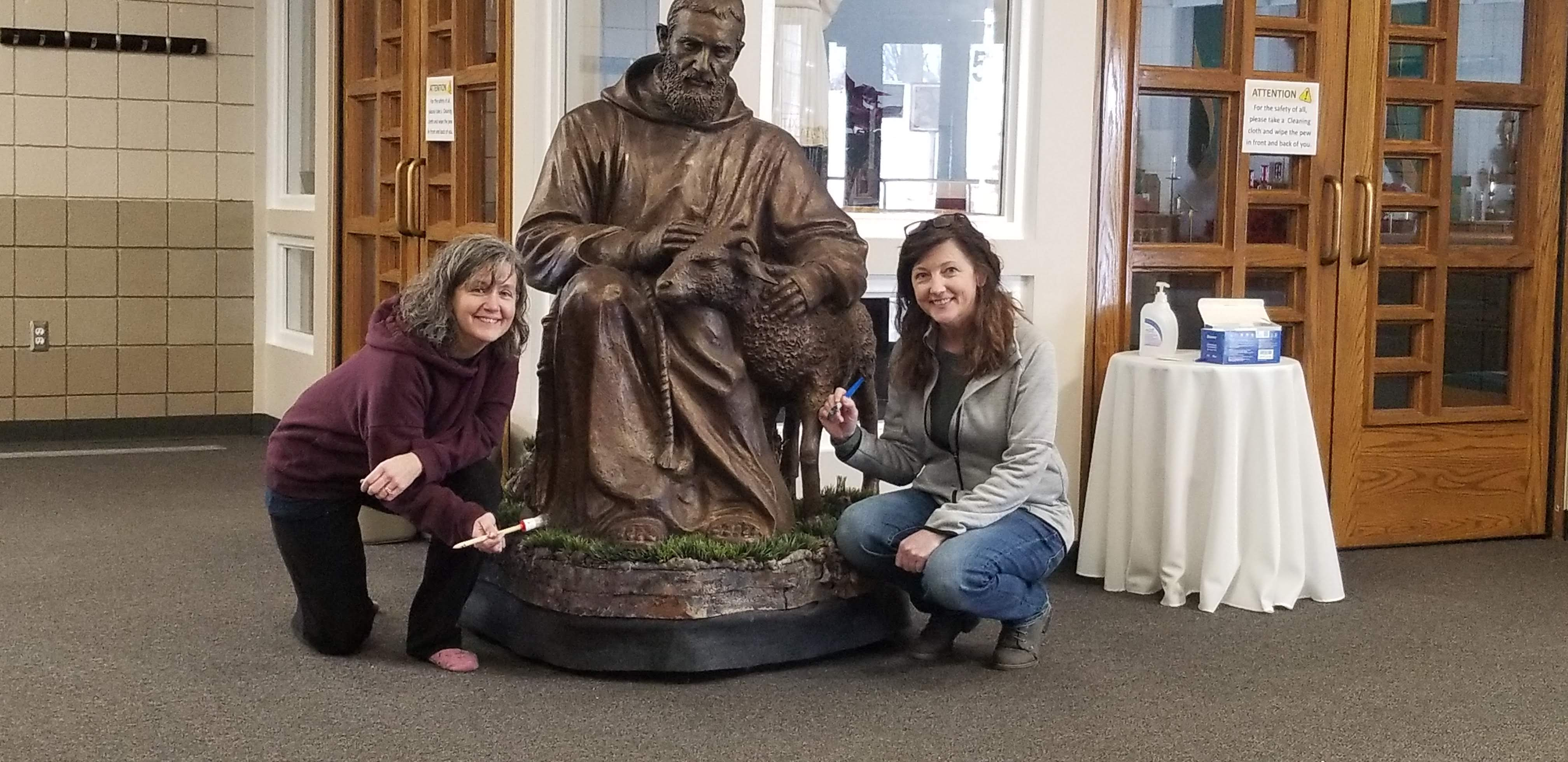 Artist Michelle Nist painting St. Pio's traveling base